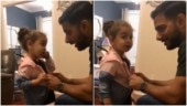 Dad questions baby girl for stealing friend's jacket. Internet is in love with their viral banter