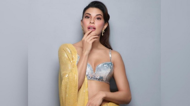 Image result for Jacqueline Fernandez in yellow sequined saree