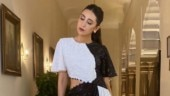 Karisma Kapoor brings a new twist to the same old black and white fashion in midi dress
