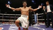 Vijender Singh outpunches Charles Adamu in 8 rounds to claim 12th successive professional win