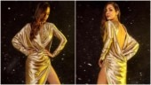 Malaika Arora in risque thigh-slit gold dress shows how to dress for a New Year bash. All pics