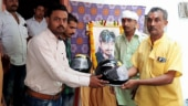 After son dies in road accident, father distributes helmets to local youth in MP