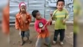Three little boys give a great performance with their made-up guitars. Rockstars, says Twitter