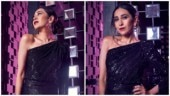 Karisma Kapoor is a glamorous diva in shimmery one-shoulder gown. See pics