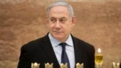 Gaza rocket forces Israel PM Netanyahu off stage at election rally