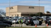 Texas church shooter wore wig and fake beard, says security head who shot him