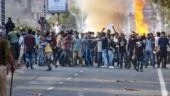 Protest in Guwahati against JNU violence, SFI activists burn effigy of PM Modi