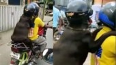 Viral video of dog riding behind its hooman wearing helmet in Tamil Nadu has the internet divided