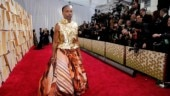 Billy Porter wows Oscars red carpet with gold feathers