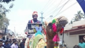 Kerala groom arrives for wedding on camel with a placard to protest against CAA
