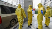 China raps 'mean' US for travel warning as virus toll reaches 213
