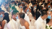 Masks and kisses: Philippine couples brave coronavirus to exchange vows