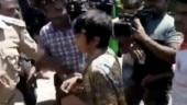Woman holds 'Kashmir Mukti.. Muslim Mukti' placard at anti-Amulya Leona protest in Bengaluru, detained