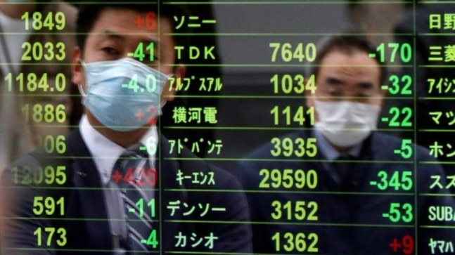 Covid-19: Asia shares suffer virus chills, central banks offer what they can