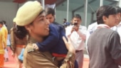 On-duty woman cop carries infant son in arms at Yogi Adityanath event in Noida. See viral pic
