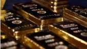 Gold gains as Covid-led growth fears spur safety buying