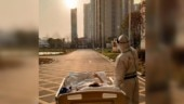 87-year-old coronavirus patient watches sunset with doctor outside Wuhan hospital. Heartwarming pic