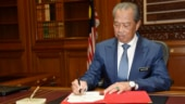 Malaysia's palace denies royal coup in appointing new PM