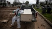 Cemetery races to keep up as New York virus deaths mount