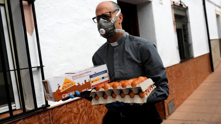 Priest Andres Conde, 49, carries food donations to be distributed to needy families during a lockdown amid Covid-19 outbreak, in Ronda, southern Spain April 18, 2020. (Photo: Reuters)