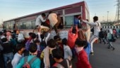 UP govt starts bringing back migrant workers, over 2,200 return from Haryana in buses