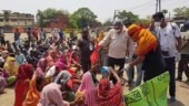 Jharkhand: Social distancing goes for a toss as BJP MLA distributes food packets