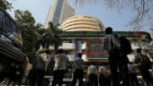 Markets trade flat as Sensex, Nifty shed early gains