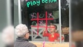 Little girl plays Tic Tac Toe with grandma while maintaining social distance. Video will melt your heart