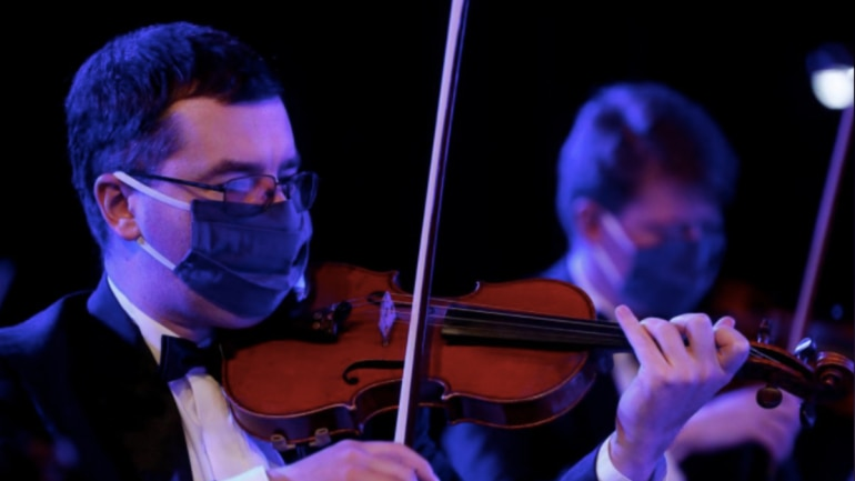 Musicians wear face masks to record concert. Photo: Reuters