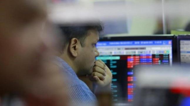 Sensex, Nifty trim losses on stimulus hopes, Reliance tumbles