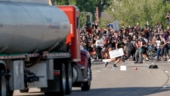 Tanker truck drives into protesters; US cities fear another night of protests