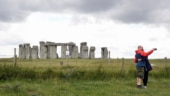 Archaeologists discover wide circle of deep shafts around Stonehenge