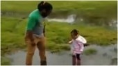 This viral video of a man playing with his daughter in a puddle will kill Monday blues. Watch