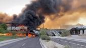 Watch: Arizona bridge catches fire, collapses after freight train derailment