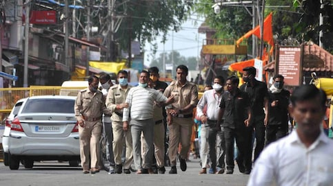 Vikas Dubey escorted by Ujjain Police on Thursday