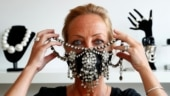 Belgian designers sell bejewelled luxury face masks. See pics