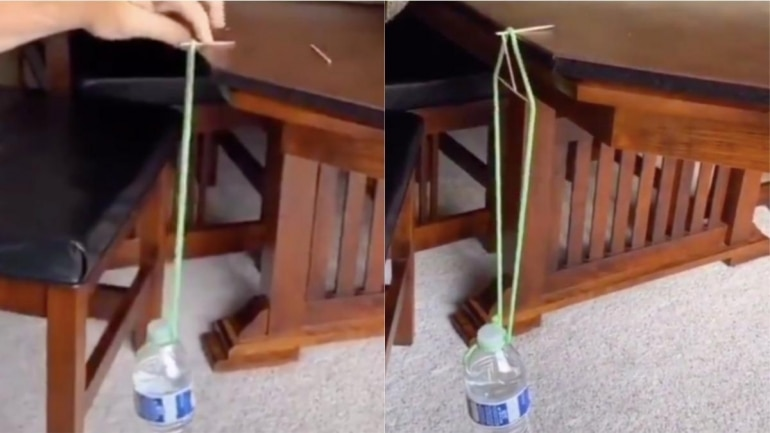 Man suspends water bottle with a toothpick. Photo: Twitter/ Physics & Astronomy Zone