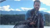 Man saves baby eagle from drowning in lake in British Columbia. Rescue video goes viral