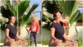 Little girl distracts mom during her yoga session in adorable viral video. Internet loves