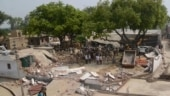 Around 60 cops at Vikas Dubey's demolished house, locals unwilling to speak