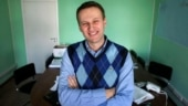 Russia's Alexei Navalny still in coma but improving