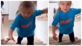 Little girl with cerebral palsy walks up the stairs for the first time in viral video. Watch
