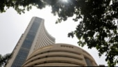 Markets end with modest gains, financial stocks extend rally