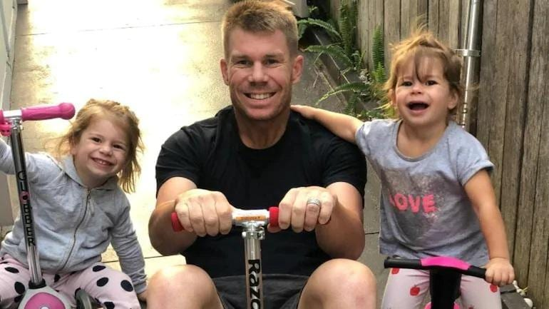 A file photo of David Warner with his daughters