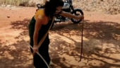 Woman dressed in saree rescues snake using mobile torch and wooden stick. Internet salutes her