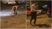 Man saves possum from being washed away in heavy rain. World needs more people like him, says Twitter