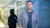 Russian opposition leader Navalny able to leave hospital bed