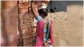 Woman balances bricks on head while carrying baby in sling at work. Maa Tujhe Salaam, says Shabana Azmi