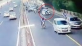 Caught on camera: Delhi traffic cop dragged on car bonnet on busy road as driver tries to flee