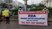 Doctors of Delhi's Hindu Rao Hospital protest over pending salaries, burn Ravana effigy